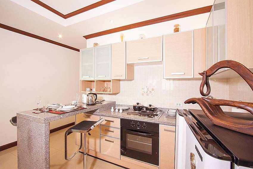 Compact kitchen with breakfast bar at Baan Sanun 4 Phuket