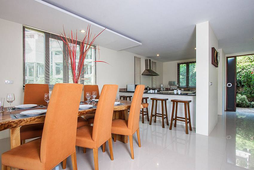 Dinning table near the kitchen of Baan Phu Kaew C1