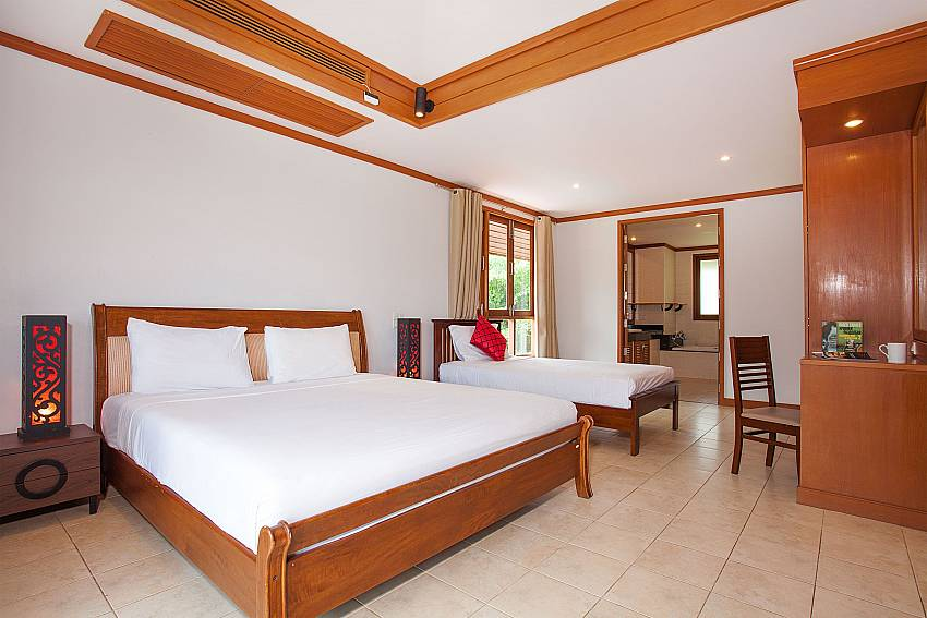 Master bedroom with double and single bed at Ban Talay Khaw B12 Koh Samui
