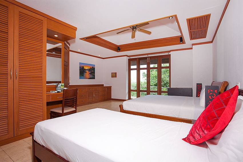 1. bedroom with one single and one double bed at Ban Talay Khaw B12 in Tongson bay Samui