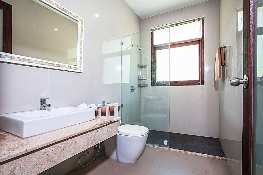 Bathroom with shower and toilet of Baan Phu Kaew C5