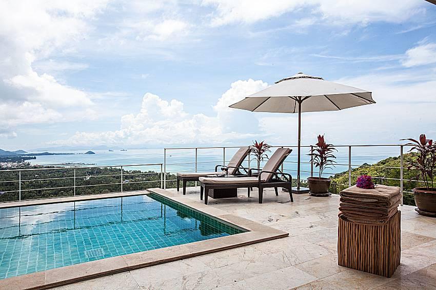 Sun bed near the pool of Baan Phu Kaew A2