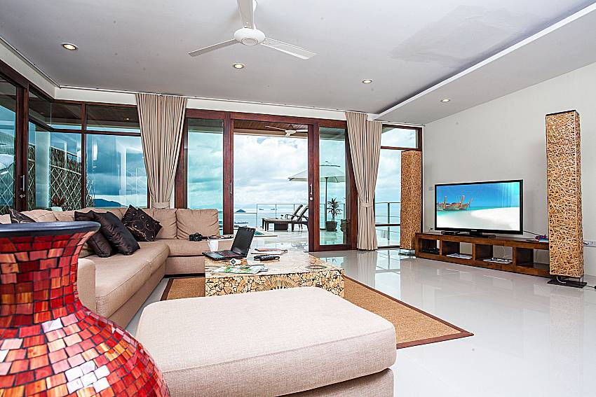 Living room overlooking outside of Baan Phu Kaew A2