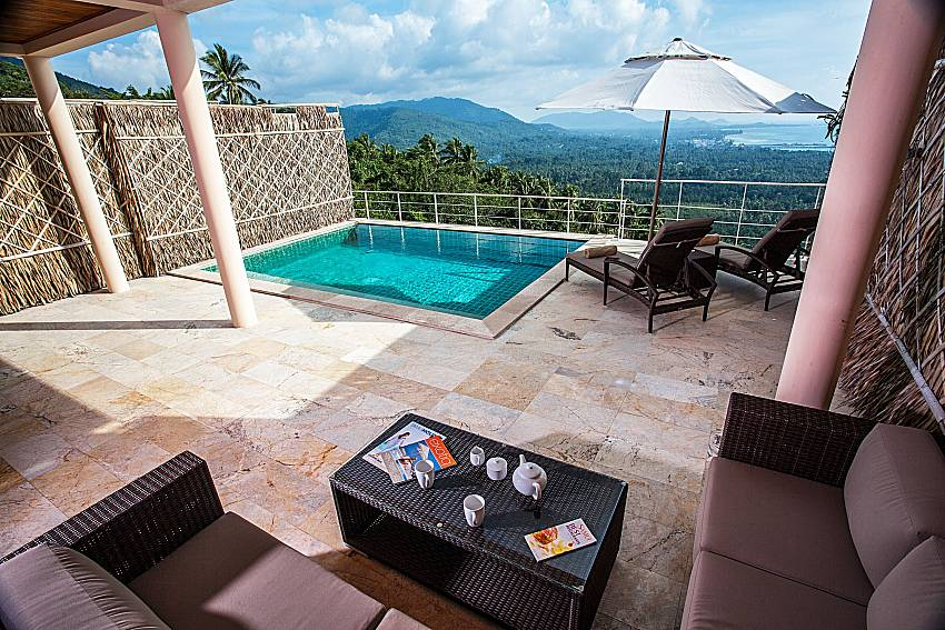 The view from the sofa to the pool of Baan Phu Kaew A3