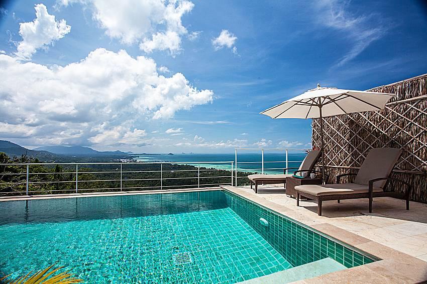 Swimming pool with sun bed of Baan Phu Kaew A4