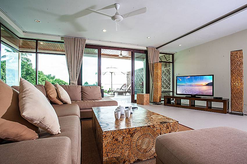 Living room overlooking outside of Baan Phu Kaew A6